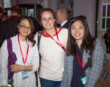 Three young researchers participating in an international conference