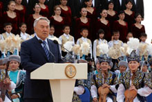 3rd Congress: The President of the Kazak Republic, Noursultan Nazaerbayev, and a multi-ethnic Kazak choir