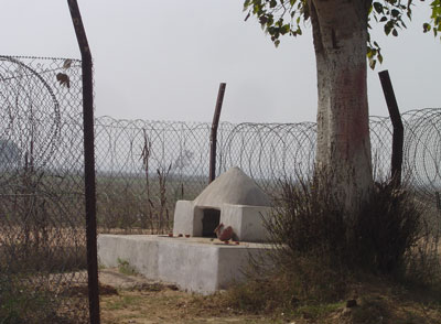 The SEZ boundary fence circumvents a temple. Reliance-Haryana SEZ in Gurgaon, notified since 2007.