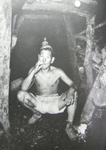 A miner working in a small mine, in the 1950s